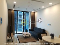 Embracing panoramic city view from a high floor in Vinhomes Golden River apartment