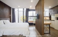 The rooftop apartment located in District 1 with modern wooden architecture and elegant design